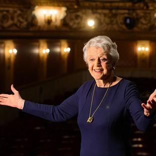 Actress Dame Angela Lansbury onstage during a photocall at the Gielgud Theatre, in central London, where she will play the role of Madam Arcati in a new production of 'Blithe Spirit', her first West End role in almost 40 years.