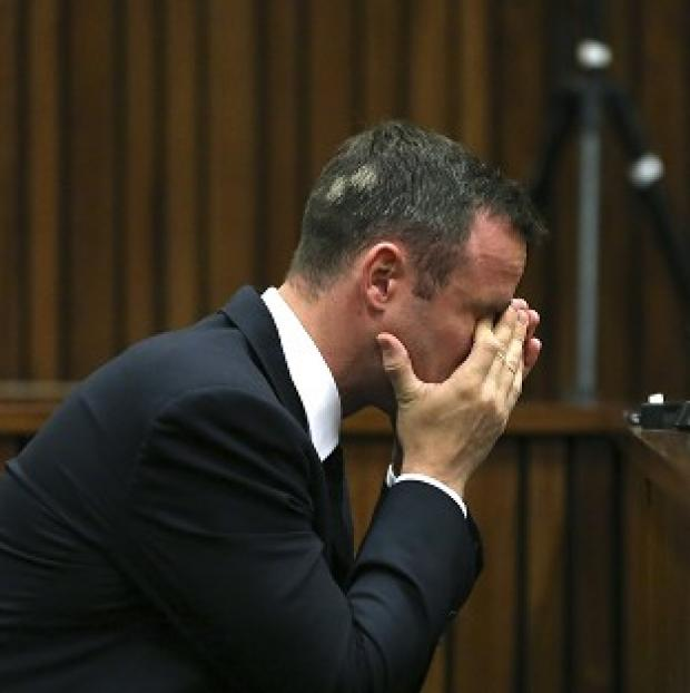 Hampshire Chronicle: Oscar Pistorius listens to ballistic evidence being given in court in South Africa (AP)