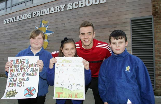Chloe Fish, Tia Douglas and Jack Charlston meet Callum Chambers with their anti-smoking posters