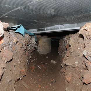 Tunnel dug to steal cash machine