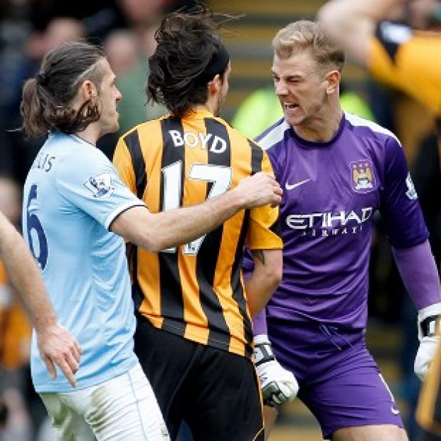 Hampshire Chronicle: George Boyd, centre, and Joe Hart, right, clashed during last Saturday's game at the KC Stadium