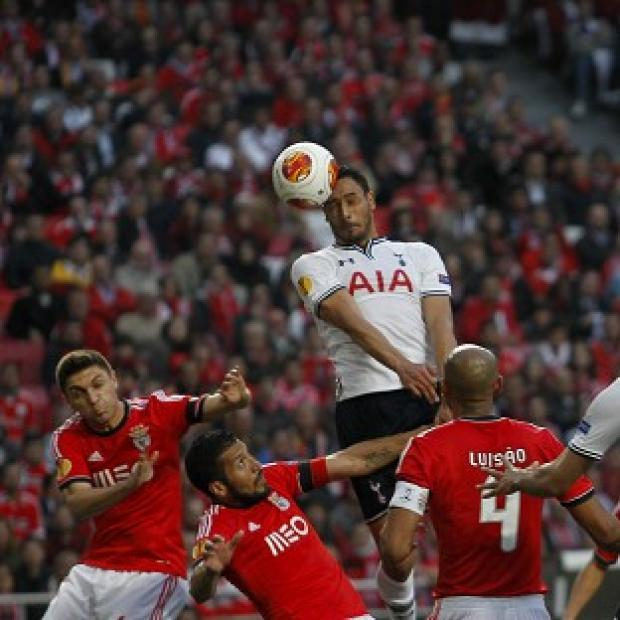 Hampshire Chronicle: Nacer Chadli, centre top, heads home for Tottenham (AP)