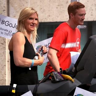 Radio 2 presenter Jo Whiley, with Greg Rutherford, during her Sport Relief Challenge on a treadmill