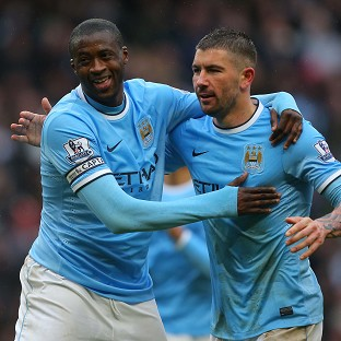 Yaya Toure (left) scored a hat-trick to lift Manchester City comfortably clear of Fulham