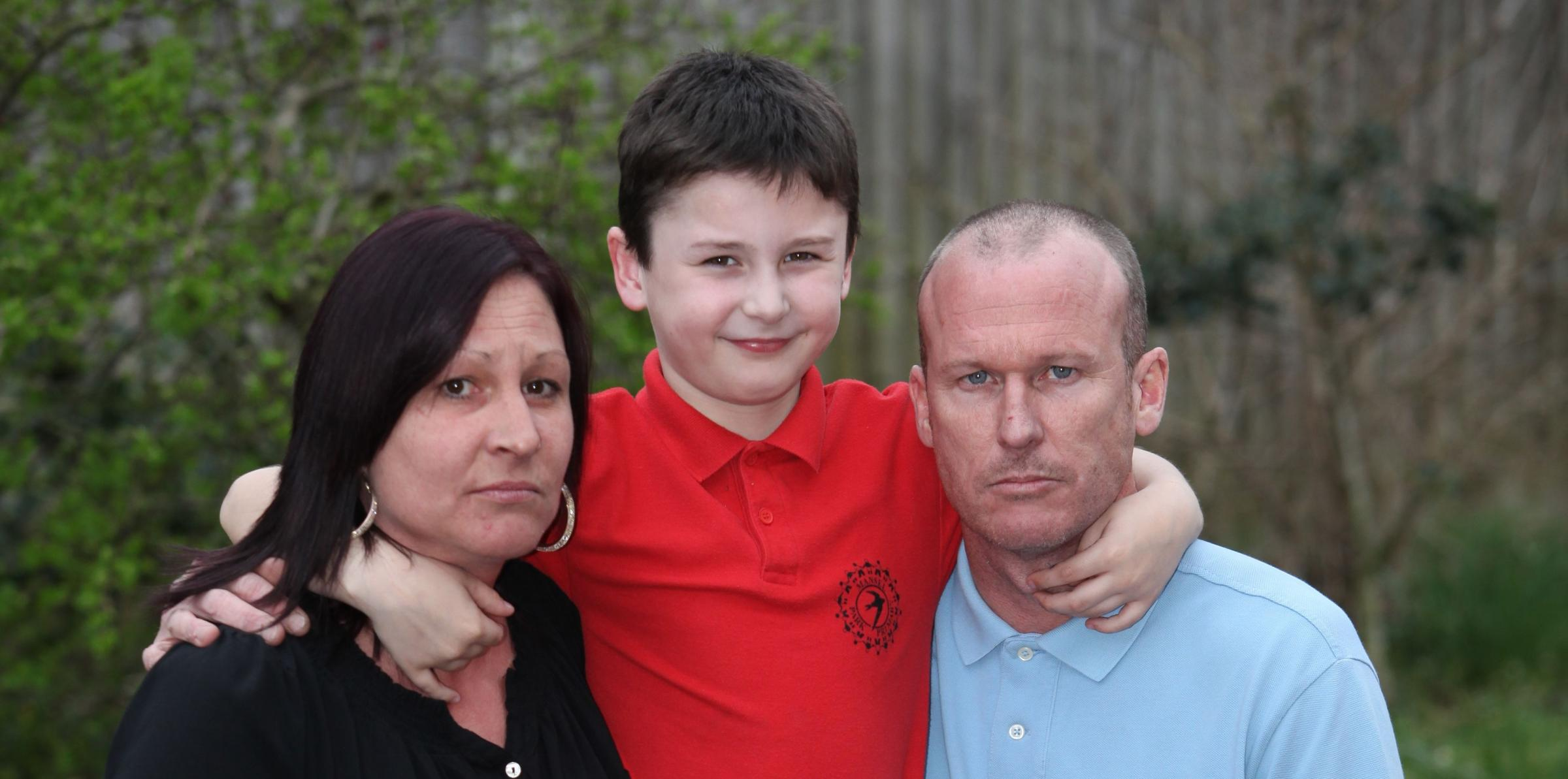 Eight-year-old Zack Harrison with parents Kelly and Ian