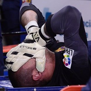 Victor Valdes was injured in the 22nd minute (AP)