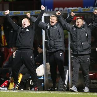 Neil Lennon, left, celebrates as Celtic clinch the title