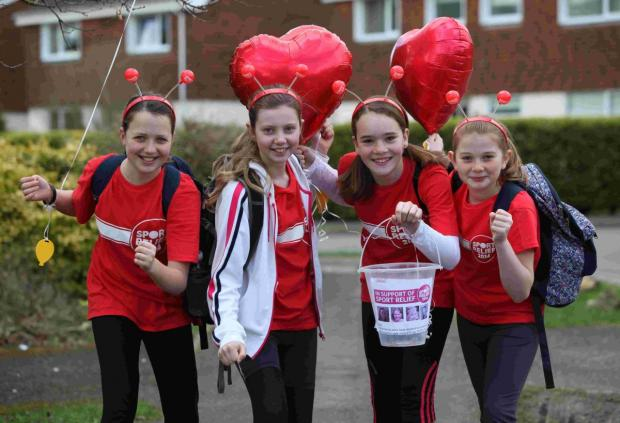 The 'Runners in Red' raised over £1,400 from their half marathon challenge on Saturday.