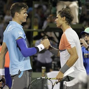 Hampshire Chronicle: Rafael Nadal, right, overcame a scare to see off Milos Raonic at the Sony Open (AP)