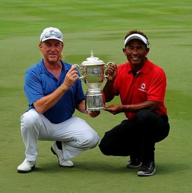 Hampshire Chronicle: Miguel Angel Jimenez, left, and Thongchai Jaidee, right, share the EurAsia Cup (AP)