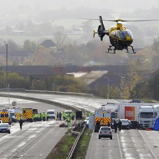 Emergency services work at the scene on the M5 m