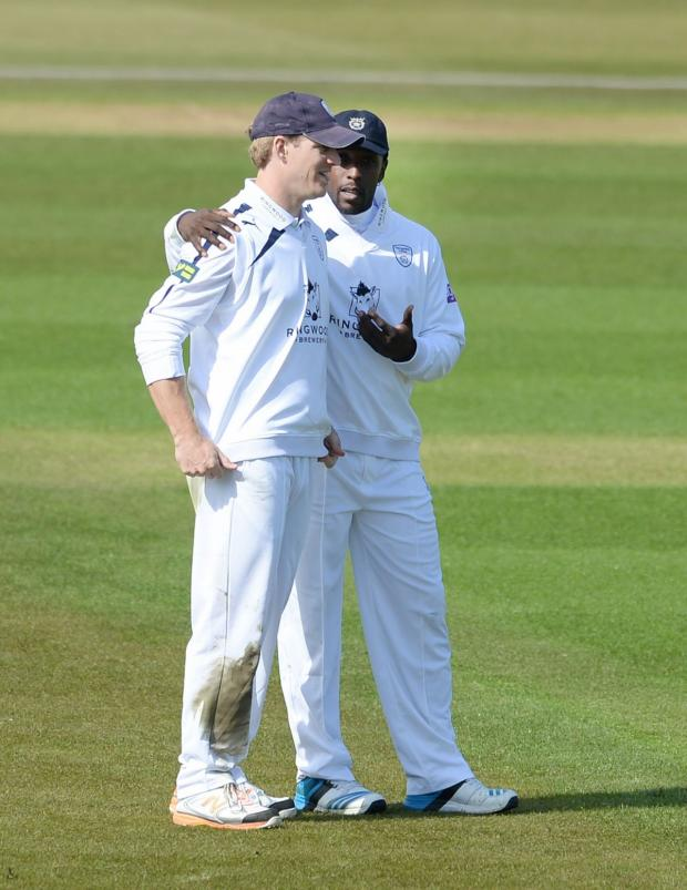 Hampshire Chronicle: Jimmy Adams and Michael Carberry talk in the field during today's friendly against Middlesex