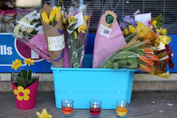 Floral tributes in Eastleigh High Street for Choudhry Zishan