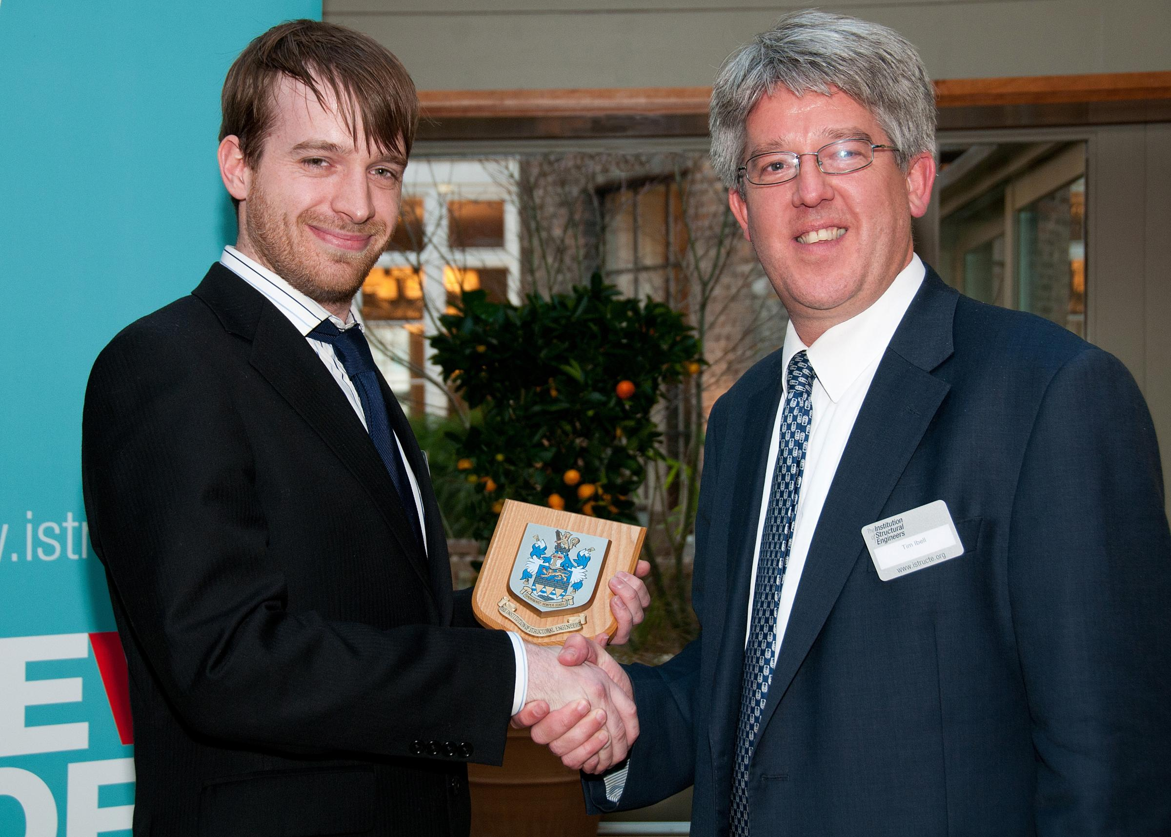 Laurence Clough receives his award from conference chairman