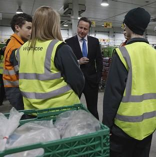 Prime Minister David Cameron speaking to apprentices at a Waitrose food distribution centre