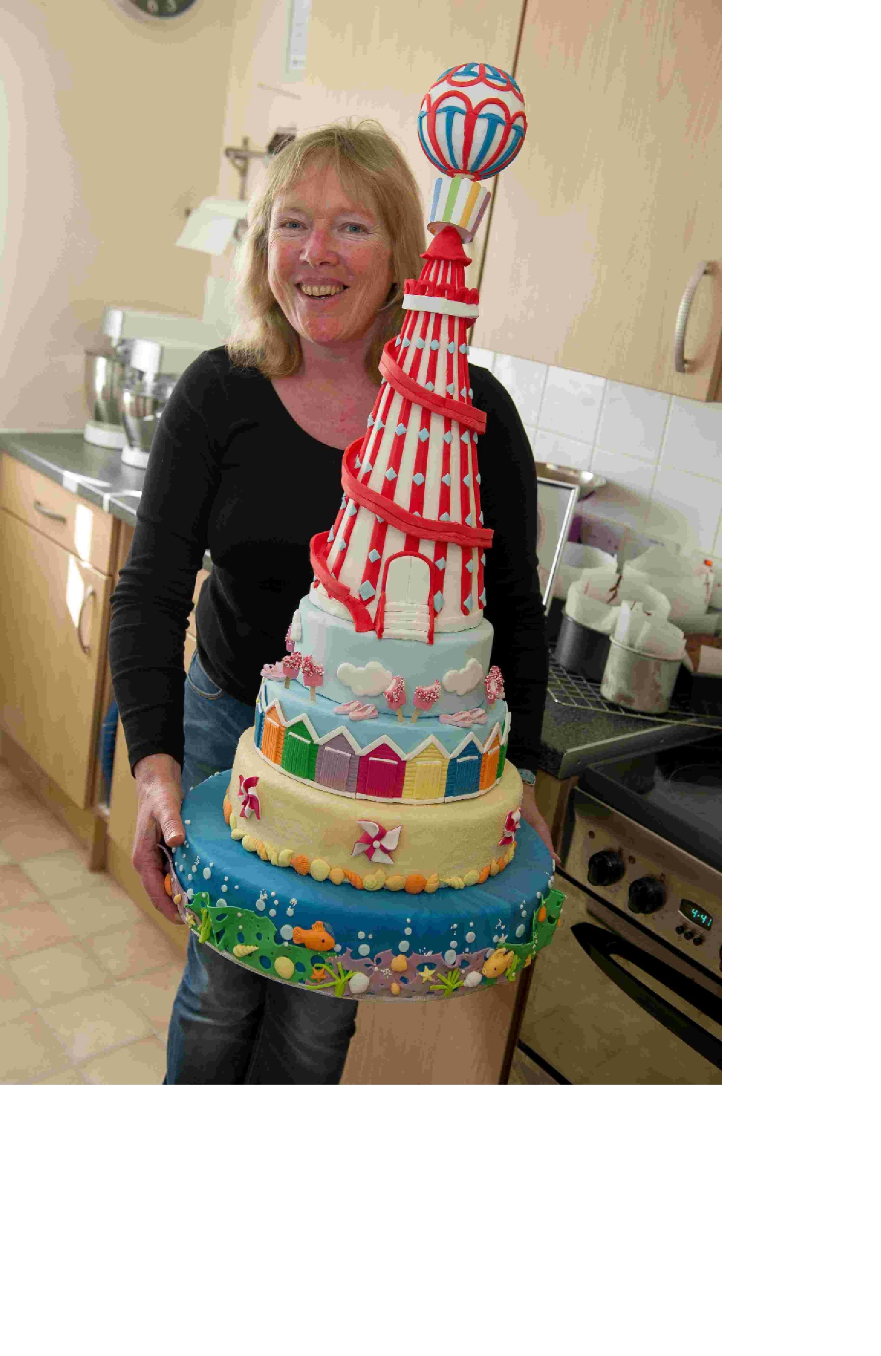 Cakemaker, Jill Chant, with her metre-high cake, which won the Showstopper class at the Southwest Cake and Bake Fest