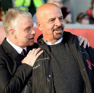 Marwan Koukash, right, said he had moved Brian Noble upstairs