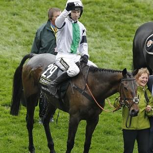 Hampshire Chronicle: Jockey Leighton Aspell celebrates winning the Crabbies Grand National on Pineau De Re