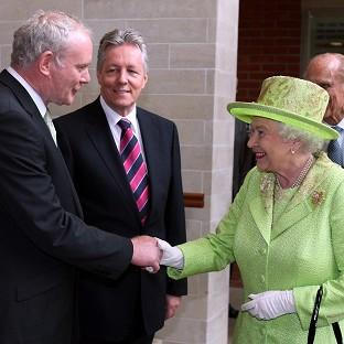 Martin McGuinness (left) will be one of the Queen's guests at Windsor Castle.