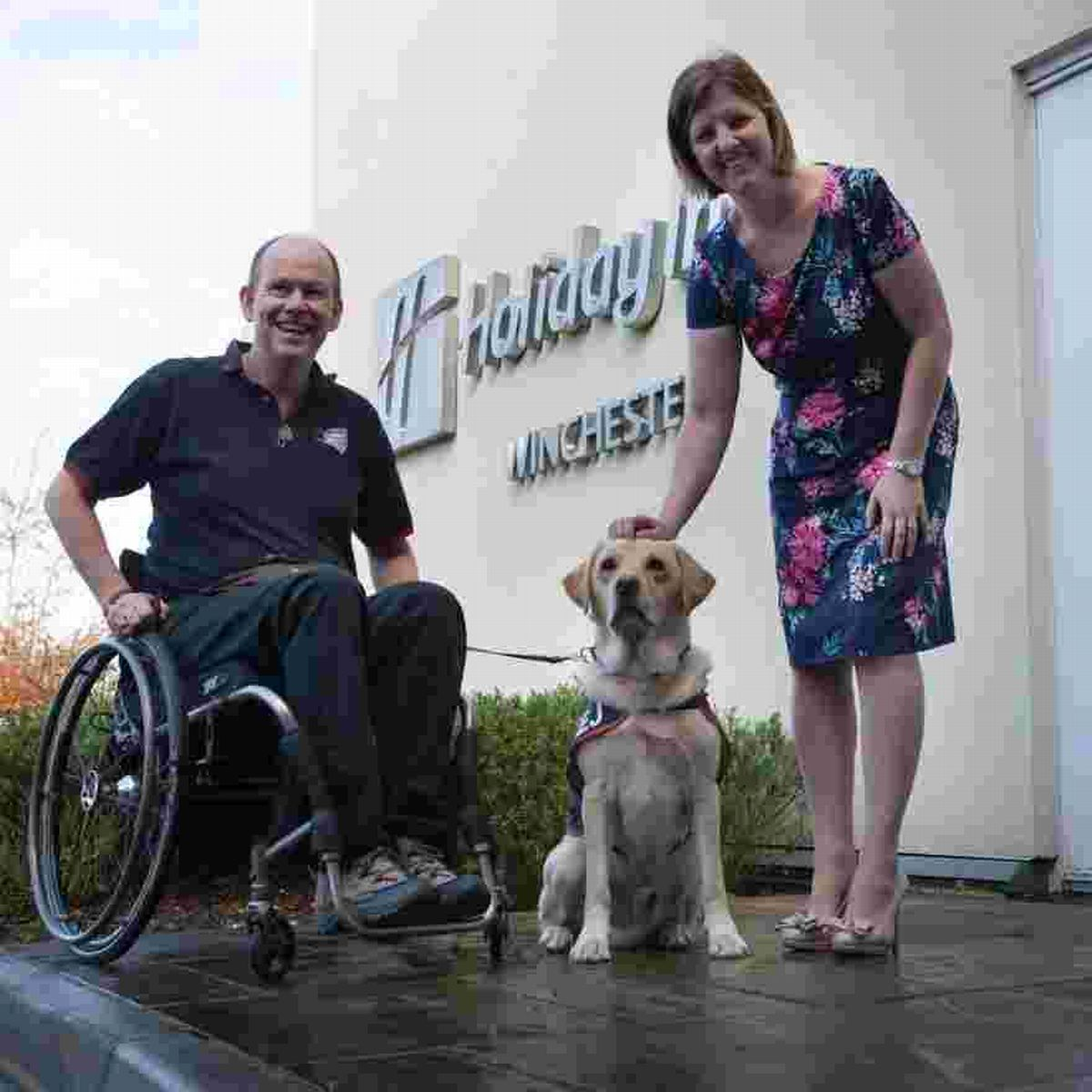 Allen Parton, Vice-Chairman and Founder of Hounds for Heroes and his dog, EJ, with Sarah Waddington, Holiday Inn Sales Manager