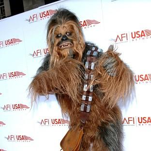 Peter Mayhew is said to be playing Chewbacca again