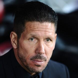 Atletico Madrid coach Diego Simeone is keeping his feet on the ground