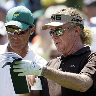 Miguel Angel Jimenez, right, fired a superb 66 at Augusta (AP)