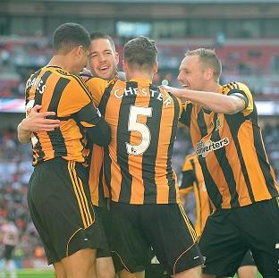 Matty Fryatt, centre, celebrates netting Hull's second goal