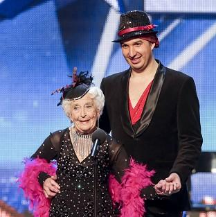Paddy Jones and partner Nico Espinosa are through to the Britain's Got Talent live shows after Amanda Holden used her golden buzzer
