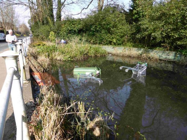 Hooligans have dumped dustbins, trolleys and even fencing into the water.