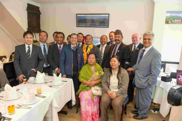 Rambahadur Limbu (pictured centre wearing yellow scarf) officially launched a new security company that will specifically hire ex-Gurkha soldiers to work within the local community