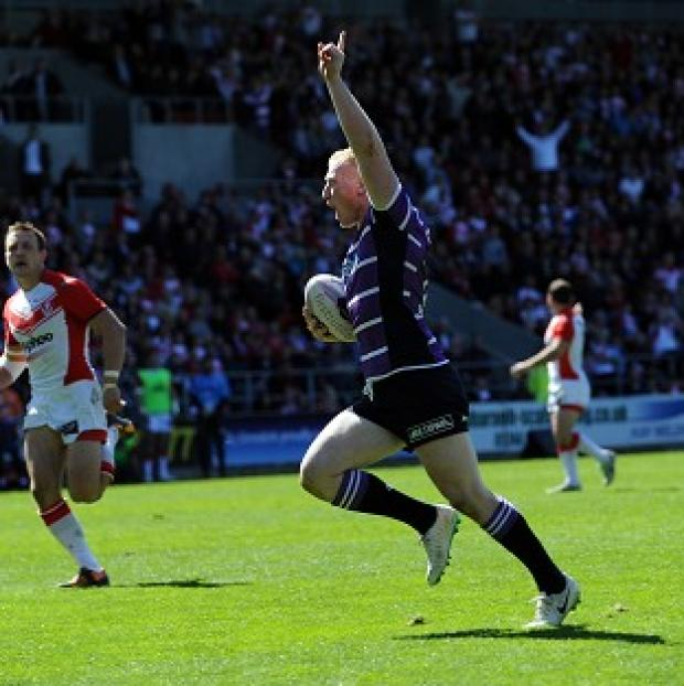 Hampshire Chronicle: Liam Farrell celebrates as he runs over to score against St Helens