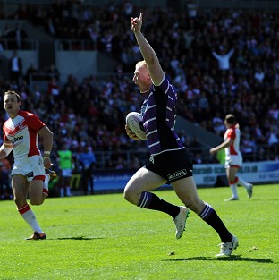 Wigan Warriors' Liam Farrell celebrates as he runs over to score a try during the First Utility Super League match at Langtree Park, St Helens.