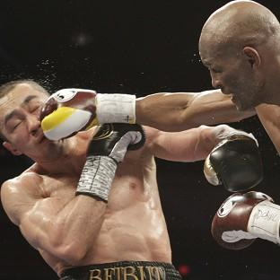 Bernard Hopkins, right, has become the oldest boxer to unify a weight division (AP)