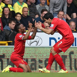 Raheem Sterling, left, and Luis Suarez, right, both scored in Liverpool's win