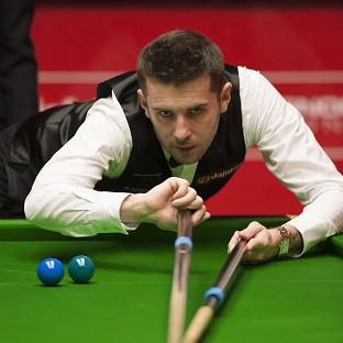 Hampshire Chronicle: Mark Selby, pictured, clung on to beat Michael White
