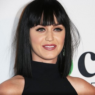 Katy Perry shows off some different looks in her new video