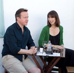 Prime Minister David Cameron was stung by a jellyfish while on holiday with his wife