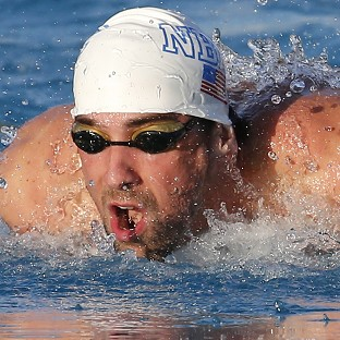 Michael Phelps, pictured, finished second to Ryan Lochte on his comeback (AP)