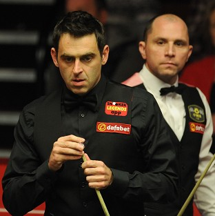 Ronnie O'Sullivan, left, trails Joe Perry, right, by two frames