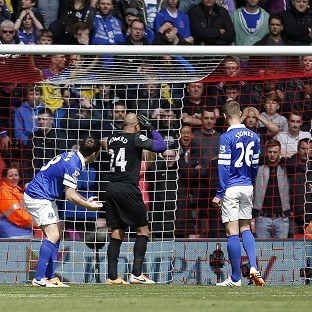 Everton's Seamus Coleman, left, heads the ball into his own net to gift Southampton their second goal