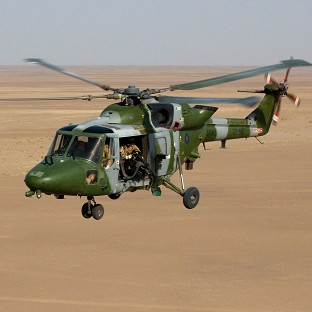 A Lynx Mk9a helicopter flies over Afghanistan (MoD/PA)