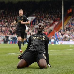 Yaya Toure celebrates after scoring