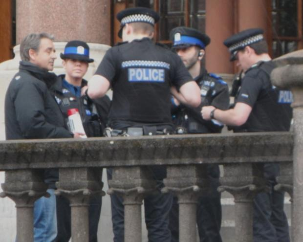 Hampshire Chronicle: Officers arrest Paul Weston outside Winchester Guildhall