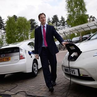 Hampshire Chronicle: Deputy Prime Minister Nick Clegg charges an electric car during a visit to the Transport Research Laboratory in Berkshire