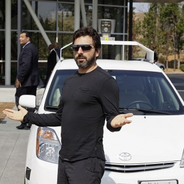 Hampshire Chronicle: Google co-founder Sergey Brin with a driverless car in Mountain View, California