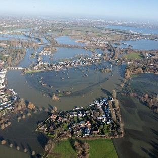 A boy died after falling ill in the flood-hit town of Chertsey, Surrey