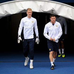 Joe Hart, left, and James Milner, right, will travel to the United Arab Emirates with Manchester CIty