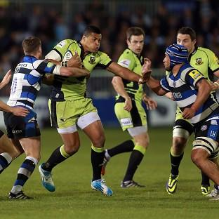 Northampton centre Luther Burrell is tackled by Bath fly-half George Ford during their Aviva Premiership clash