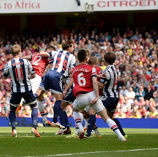 Olivier Giroud, left, heads home the winner